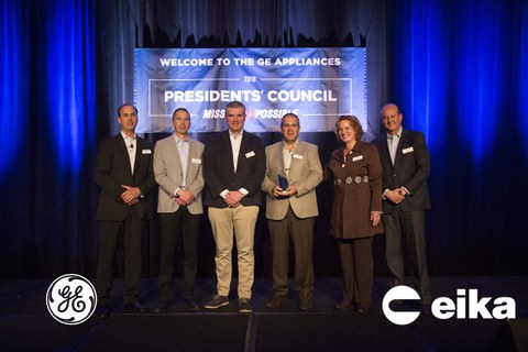 Eika receives the Distinguished Supplier award from General Electric